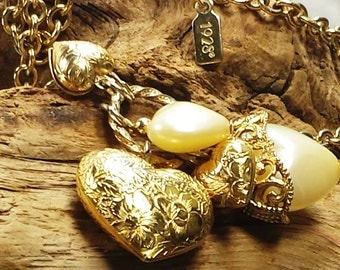 Vintage 1928 Gold Tone Necklace with Gold Tone Filigree & Faux Pearl  Hearts