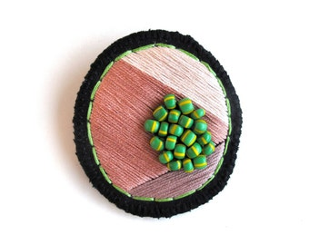 Geometric brooch embroidered marsala and tan colors with green African beads on black muslin with black felt Spring fashion
