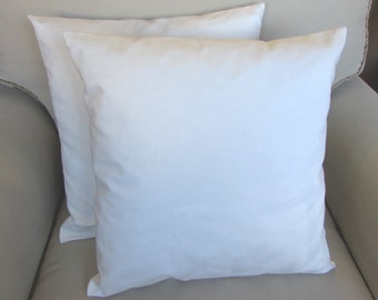 pair of white organic cotton pillow covers with inserts