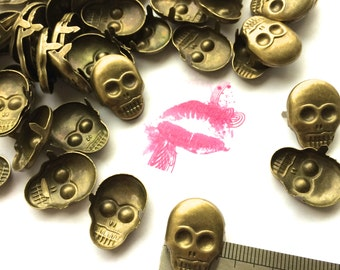 Metal SKULL Two Prong Studs. Use for Clothing etc. Choose Quantity. Avail. in Brass, Gold, Silver, Gun Metal. FAST Shipping for US Buyers.