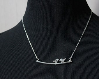 Bird necklace. silver bird. silver bird necklace. bird on a branch. bird in silver. 2 birds. animal necklace. woodlands. nature