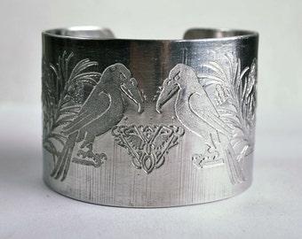 Ravens design embossed cuff silver aluminium large, based on Mucha
