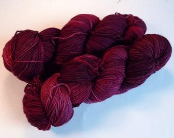 Dark Cherry on Max 80/20 SW Merino Nylon Hand dyed fingering weight sock yarn