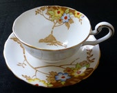 Antique Victoria C & E Cartwright and Edwards Porcelain Cup and Saucer Brown Tree with Multi-Colored and Enameled Flowers Ca. early 1900's