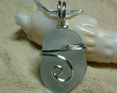 Drilled and wire wrapped pale blue sea glass necklace with sterling silver chain