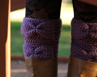 The All In A Row Purple Dream Bow Boot Cuffs.