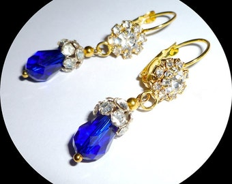 Sparkling cobalt blue quartz teardrops with crystal caps and hinged wires.