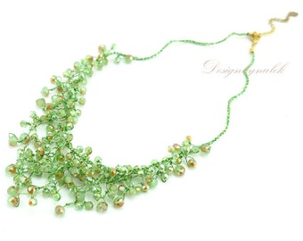 Peridot hand knotted on silk bracelet.