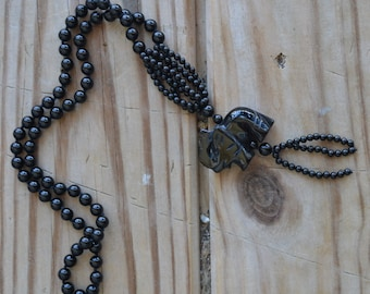 Beautiful vintage black onyx glass art deco style necklace with carved elephant pendant