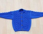 babies blue hand knitted aran style cardigan