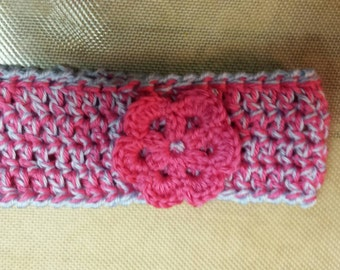 Crocheted headwarmer with rosette.