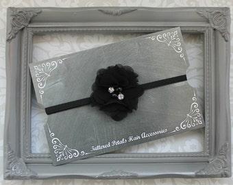 Elegant black flower with pearls and rhinestones on adjustable elastic headband