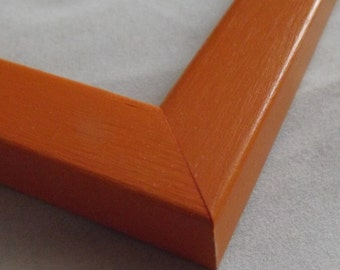 11 x 14 Ready to ship Picture Frame ~ Flat profile with rounded edges ~ Orange ~ 3/4 inch wide x 1/2 inch tall x 3/8 inch deep Moulding