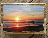 Color photograph featuring a sunrise over the ocean in Ocean City Maryland transferred onto reclaimed boardwalk wood