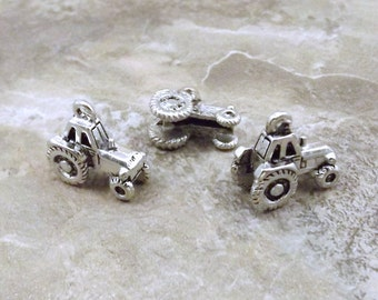 Three (3) Pewter Farm Tractor Charms - 1906