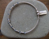 Sterling Siver Gratitude Stretch Sterling Silver and Hill Tribe Tube Beads and Iridescent Faceted Gray Blue Crystals