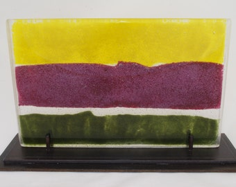 Glass sculpture in canary yellow, fuchsia and pine green