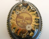 Steampunk sun on Black with silver colored pendant