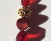Red 4 with gold key clasp