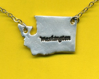 Handcrafted from recycled silver, this Washington State pendant hangs from a sterling silver chain