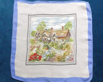 Handkerchief, vintage, it features in the centre a thatched cottage with a lovely garden, blue border, c1950's.