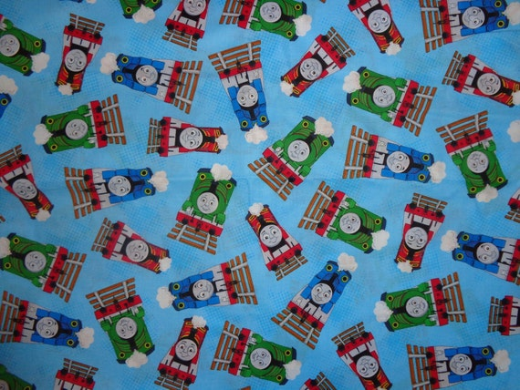 Blue thomas train toss cotton fabric by the yard for Train fabric by the yard