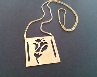 Handcutted Pendant made from Brass and gold plated chain
