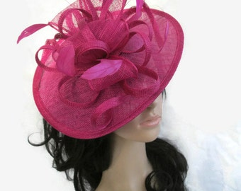 Pink Fascinator.Stunning Fuschia Pink Sinamay Shaped disc Fascinator with double swirls , loops..wedding,races