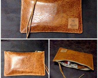 Simple Clutch made of fine leather with golden highlights