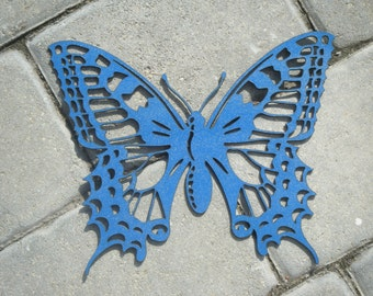 Cut and painted wooden ornamental butterfly. Cheerful and original wall decoration.