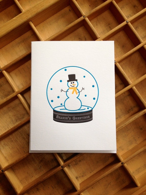 15558250 snowglobe with snowman and christmas tree inside on a blue