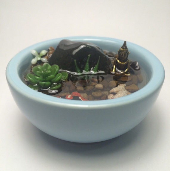 Resin koi fish pond with miniature bronze buddha submerged for Resin koi fish