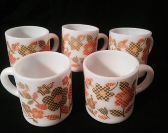 5 Milk glass mugs with orange, yellow and green flowers