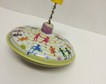 Vintage Collectible Spinning toy, collectible toy, spinning metal toy