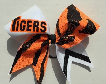 "Orange black and white ""Tigers"" cheer bow. Ask about bulk discounts, color and mascot options."