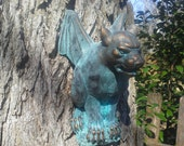 Gargoyle coming out of the tree, wall, fence, gate cement bronze scuplture