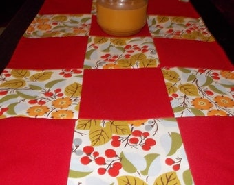 Table runner patchwork  approx 15 x 35 Red with flowers reversible.