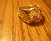 Sterling silver open round Claddagh ring