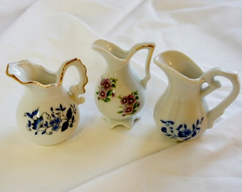 Lot 3 miniature floral pitchers shadowbox or porcelain collection blue and lavender flowers
