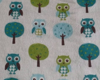 Blue,Turquoise and Lime Green Owls and Tree print blanket.  Trimmed with rick rack