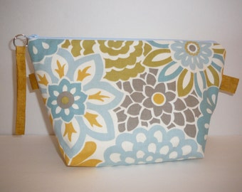 Pretty blues and gold wedge bag with off white lining.