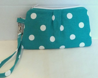Turquoise wristlet, clutch, wrist wallet.  Turquoise and white polka dot with multi colored elephant lining and detachable wrist strap