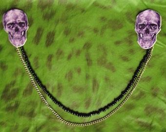 Double skull brooch