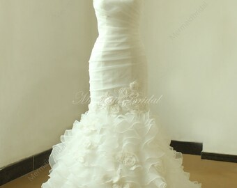 Ivory fit and flare organza wedding dress with sweetheart neckline and handmade flowers