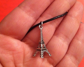 Eiffel Tower charm on a leather cord, Eiffel Tower jewelry, Paris theme pendant, gift for her
