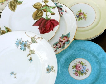 Mismatching mixed antique vintage dessert or salad plates