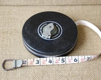 Vintage industrial Keuffel and Esser leather tape measure, antique leather tape measure