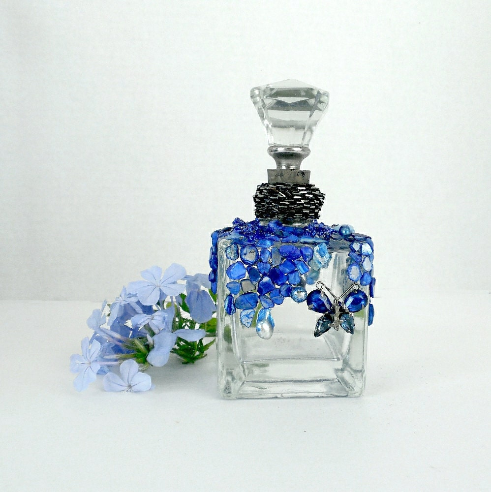Altered shell glass bottle decorative display bottle unity for Glass bottle display ideas