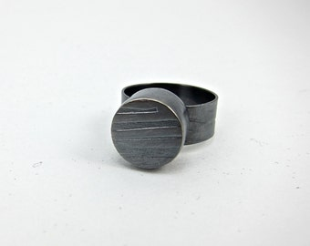 elegant hollow form ring made of sterling silver, oxidized