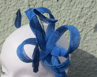 Blue fascinator made china blue sinamay loops and matching feathers on alligator clip.